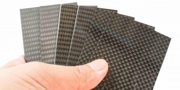 carbon fiber specimen sample plate in hand holder on white isolate with path linebackground